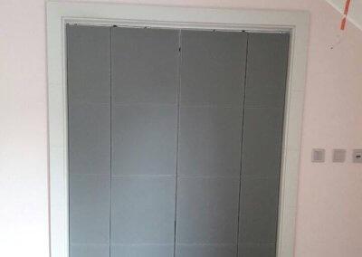 Porte intérieure coulissante pliante gainée cuir - LAROCHETTE