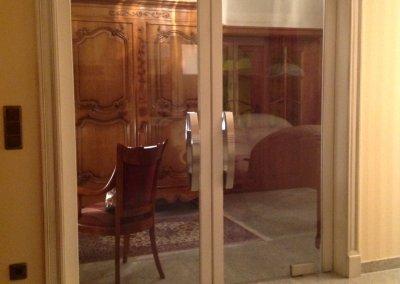 Double porte en verre avec incorporation de bois ébrasement de style