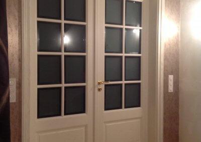 Double porte vitrée, croisillons bois, verre biseauté